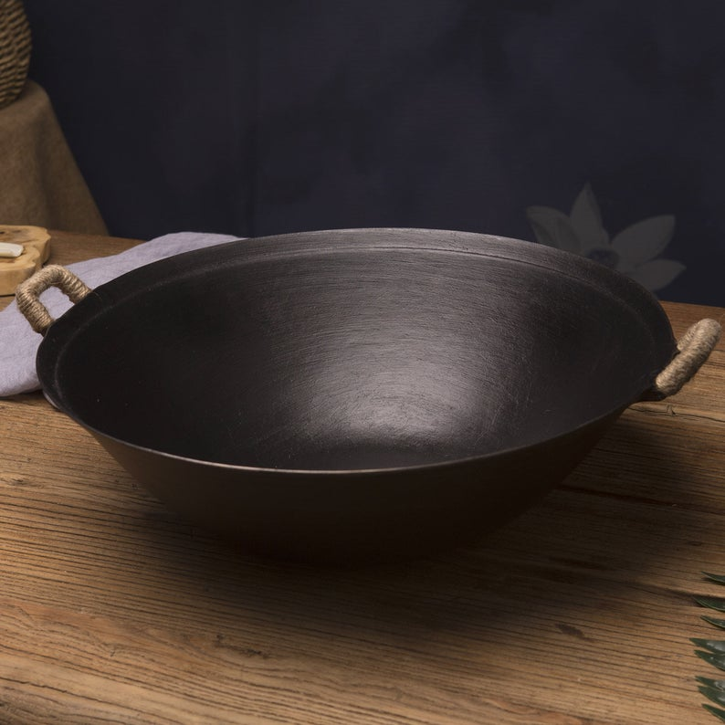 This cast iron wok has two short handles, so consider your preference when making a purchase