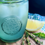 A refreshing Lemon Spritzer mocktail in a recycled glass